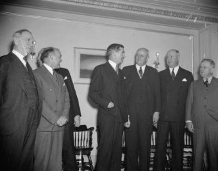 1938 photo Cabinet members chat with Anthony Eden. Washington, D.C., Dec. 13. b7